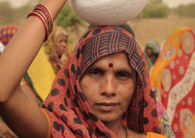 Undeterred, a woman walks forward. She carries an earthen pot to symbolise the fight for the ceaseless presence of water in it.