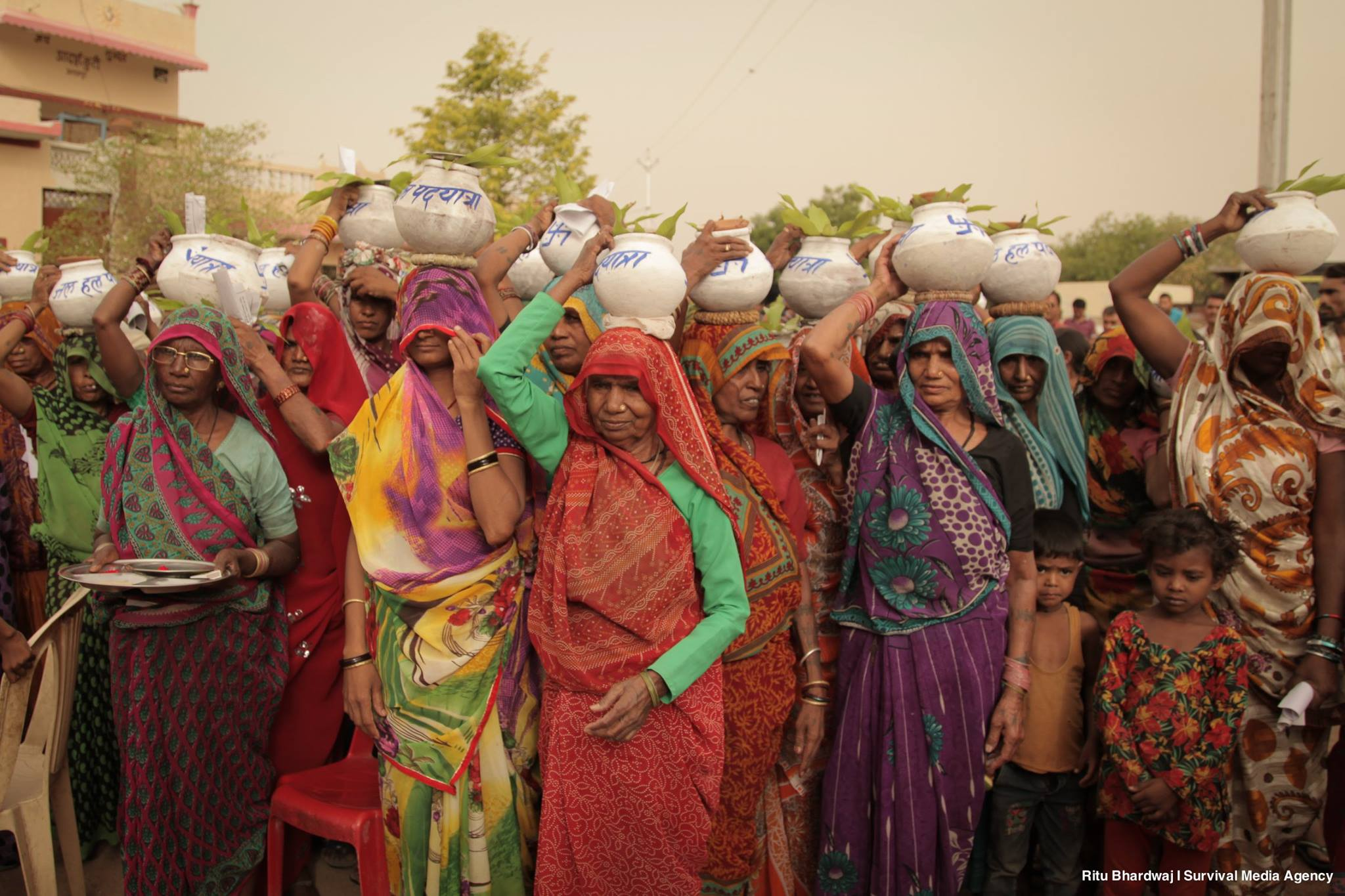 Women from Alampura, Madhya Pradesh get ready to embark on a farmer's foot march. Recurrent drought in the last two years has crippled villages in 11 states both socially and economically. However, people all along the affected areas are pushing for sustainable solutions. People in hundreds marched for 200 kms from Marathwada to Bundelkhand to take a stand against the lack of action by the government in securing the livelihood of almost 540 million people affected by the silent disaster.